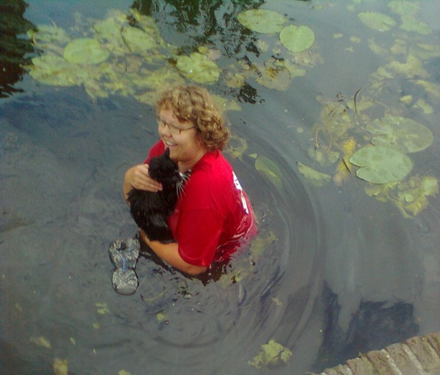 one of the volunteers saved cat Melvin from a floating island (put in the canal to prevent cats from drowning)
